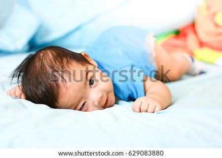 korean baby boy bedroom. Portrait of a crawling baby boy in white sunny bedroom  Newborn child relaxing bed Free photos South korean Avopix com