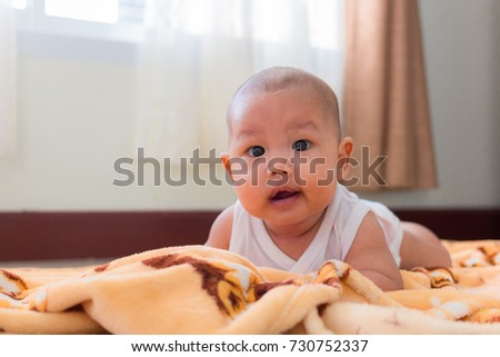 Portrait of a crawling baby on the bed. #730752337