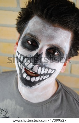 portrait of a creepy skeleton guy perfect for Carnival (brick wall background)