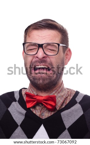 Portrait of a crying nerd. Isolated on white.