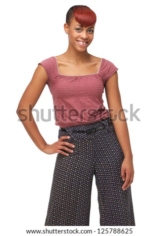 Portrait of a cute African American girl with hands on hip