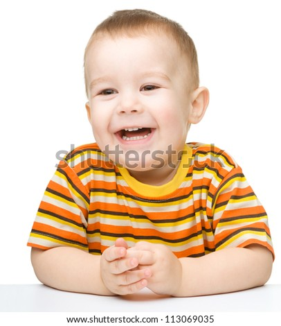 Portrait of a cute and cheerful little boy, isolated over white