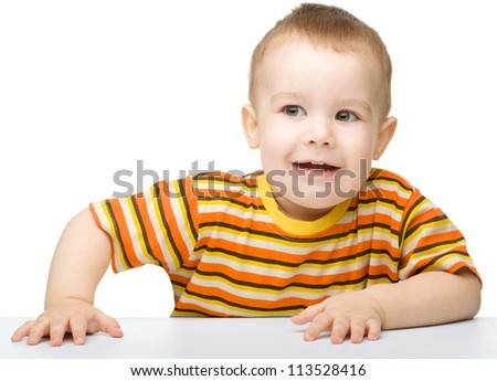 Portrait of a cute and cheerful little boy, isolated over white - stock photo