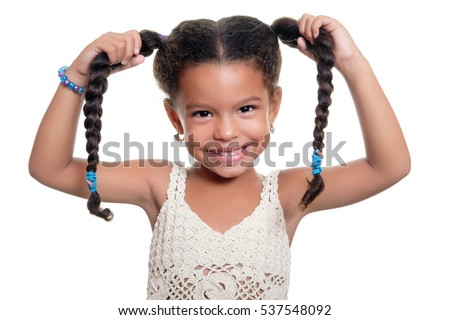 Portrait of a cute and funny  african american small girl isolated on a white background
