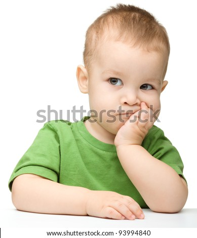 Portrait of a cute and pensive little boy support his head with hand, isolated over white - stock photo