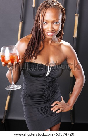 Portrait of a cute black girl handling a cold cocktail