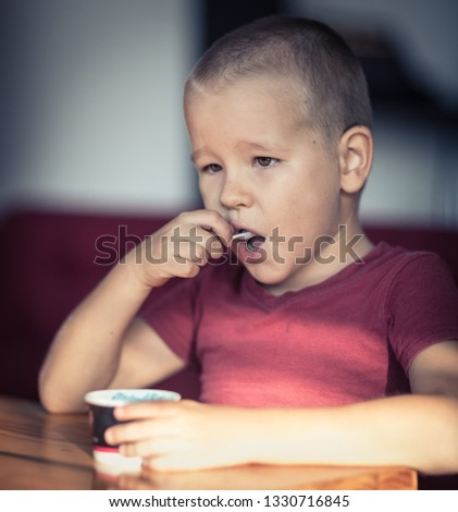 Portrait of a cute boy eating ice cream. #1330716845