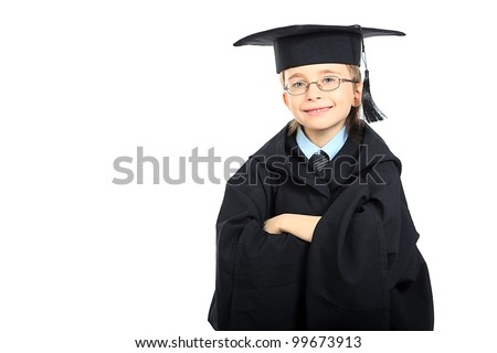 Portrait of a cute boy in a graduation gown. Education. Isolated over white.
