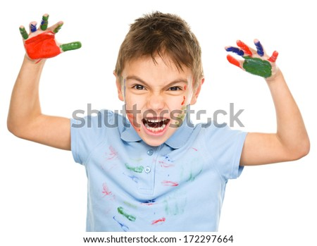 Portrait of a cute boy showing her hands painted in bright colors, isolated over white - stock photo