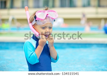 Portrait of a cute boy wearing a mask for diving in swimming pool