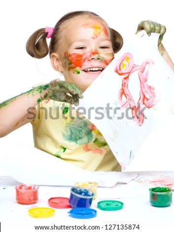 Portrait of a cute cheerful girl showing her drawing, isolated over white