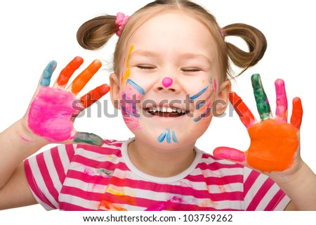 Portrait of a cute cheerful girl with painted hands closed her eyes in joy, isolated over white