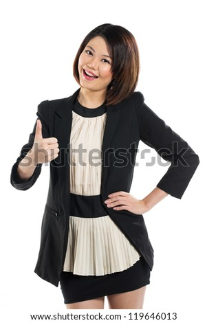 Portrait of a cute chinese businesswoman giving the thumbs up