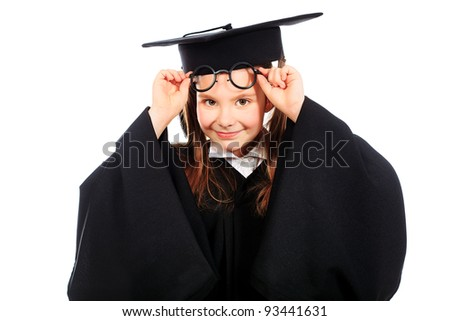 Portrait of a cute girl in a graduation gown. Education. Isolated over white.