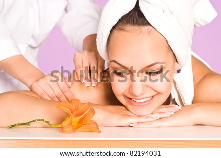 portrait of a cute girl lying at massage