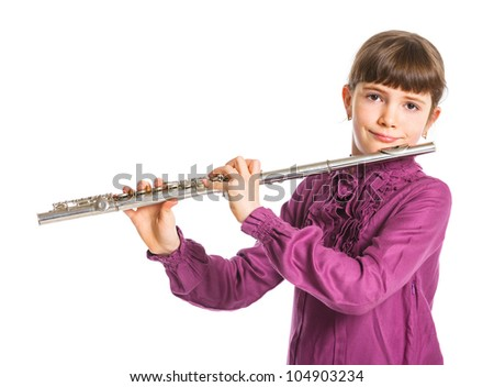 Portrait of a cute girl playing transverse flute. Isolated on a white background