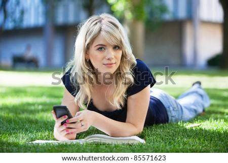 Portrait of a cute girl using cell phone