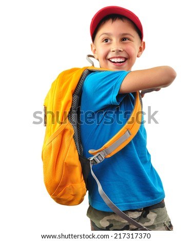 Portrait of a cute happy smiling little boy with yellow backpack and a red cap looking back. Isolated over white background. Happiness childhood travel concept