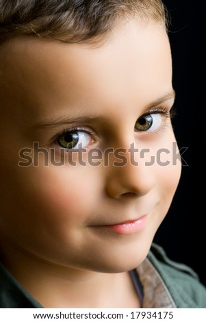 Portrait of a cute kid on a black background