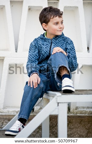 Portrait of a cute kid outdoor in an urban environment