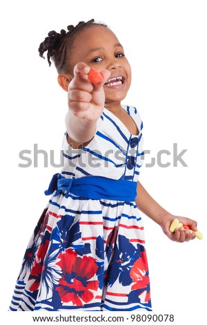 Portrait of a cute little african american girl eating candy, isolated on white background