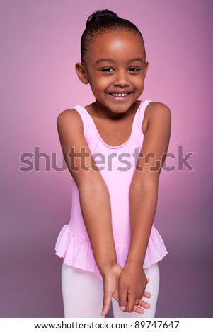 Portrait of a cute little African American girl wearing a ballet costume