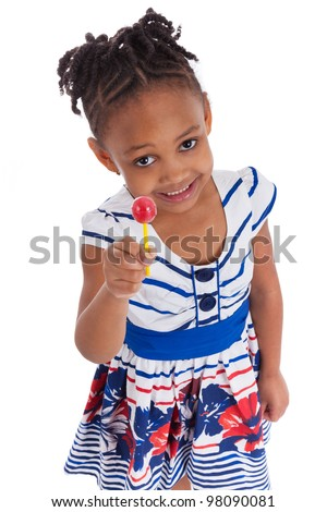 Portrait of a cute little african american girl with a lollipop, isolated on white background