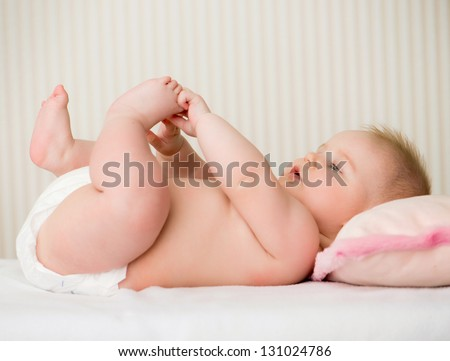 portrait of a cute little baby lying