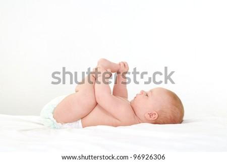 portrait of a cute little baby lying