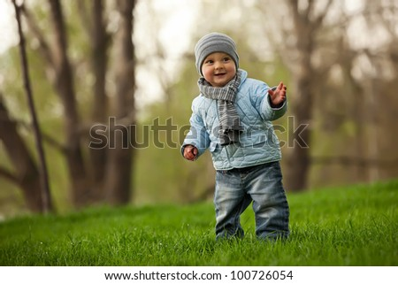 Portrait of a cute little boy in a spring park
