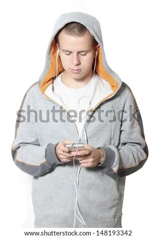 Portrait of a cute little boy listening to music on the mp3 player #148193342