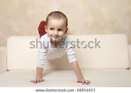 Portrait of a cute little boy on a sofa