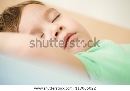 Portrait of a cute little boy sleeping in bed