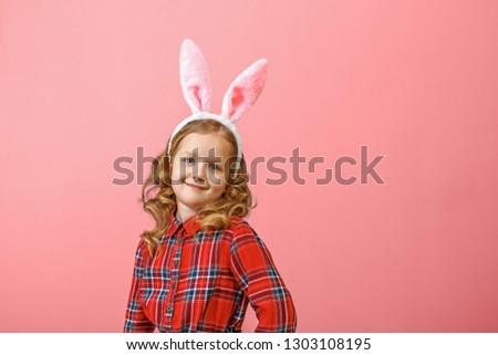 Portrait of a cute little child girl with bunny ears on a colored background. Happy easter  #1303108195