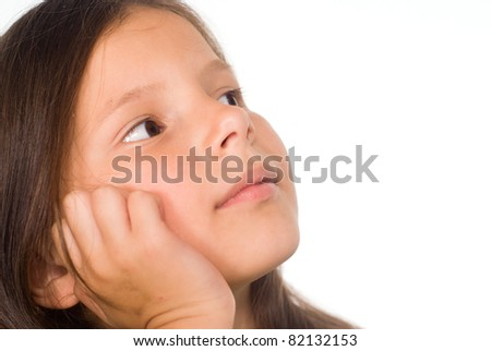portrait of a cute little girl dreaming
