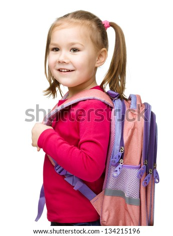 Portrait of a cute little schoolgirl with backpack, isolated over white