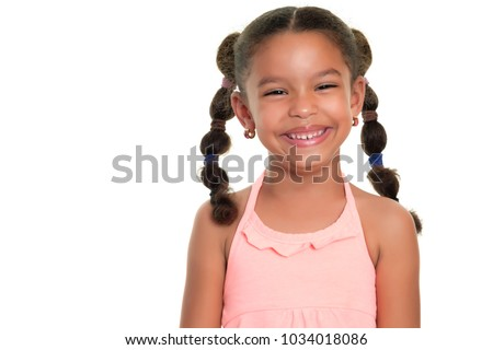 Portrait of a cute multiracial small girl smiling  - Isolated on a white background #1034018086