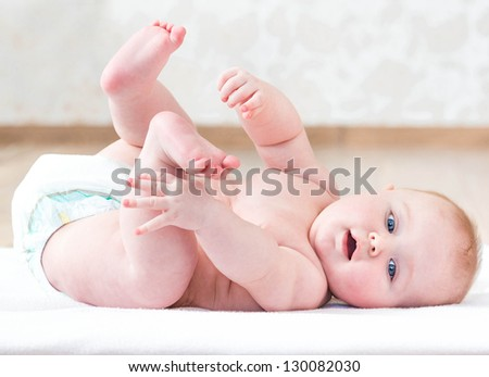 Portrait of a cute naked baby close-up