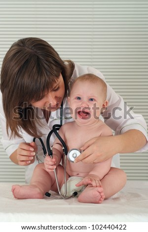 portrait of a cute nurse with baby