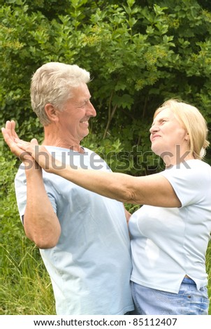 portrait of a cute old couple dancing