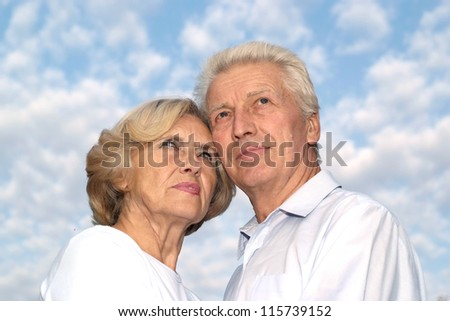 portrait of a cute old seniors at sky