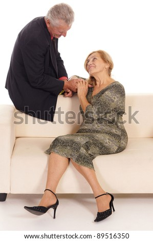 portrait of a cute old woman and man at sofa