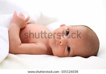 Portrait of a cute one-week old baby boy