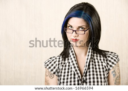 stock photo Portrait of a cute rockabilly woman with tattoos on her arms