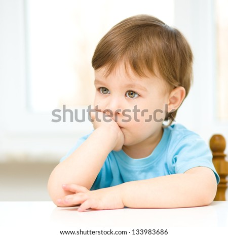 Portrait of a cute thoughtful little boy
