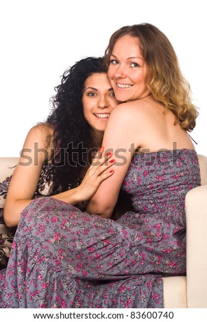 portrait of a cute two girls at sofa