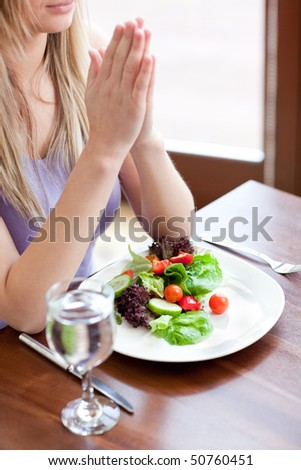 Portrait of a cute woman eating a salad in a living-room #50760451