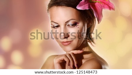portrait of a cute woman on a brown background
