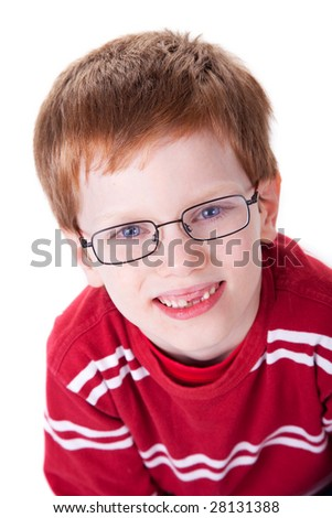 Portrait of a cute young boy with glasses isolated on white background. Studio shot.