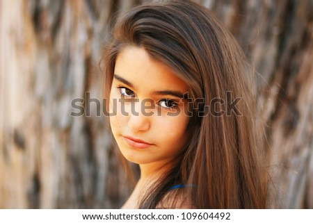 Portrait of a cute young brunette girl